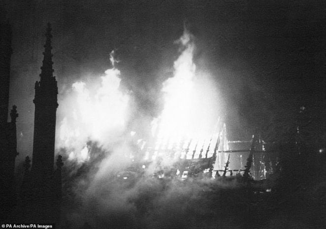 Pictured: The roof of the South Transept of York Minster ablaze at the height of the fire. Minster staff and clergy busied themselves saving as many artefacts as possible before the fire was finally brought under control at around 5.24am