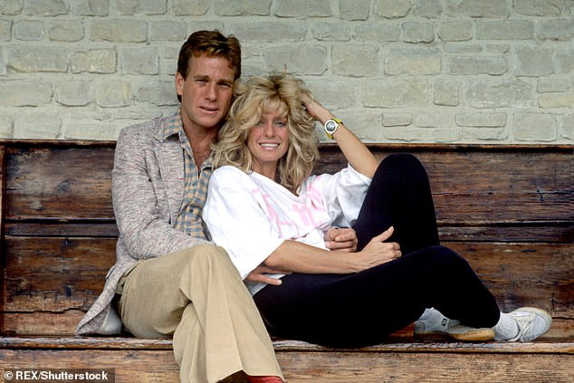 Star crossed lovers:Farrah and Ryan had Redmond together back when they were still an item, prior to her death in 2009. Pictured together in 1984