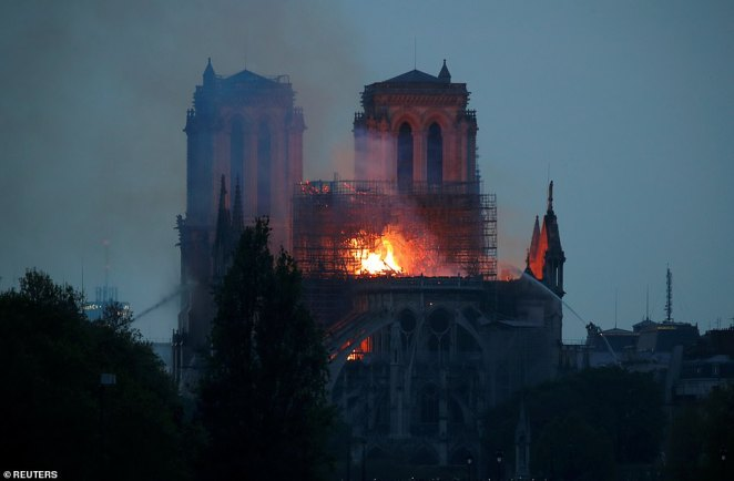 Firefighters using hoses from all four sides of Notre Dame to try and douse the flames which tore through the building at a startling pace