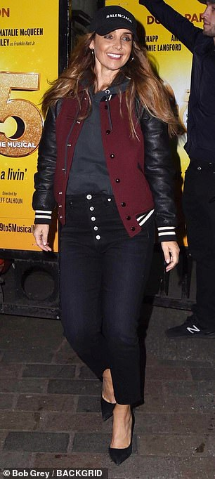 She added a flair with a Balenciaga designer touch cap