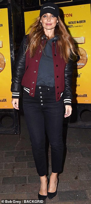 Louise elevated her look with a pair of black suede pumps
