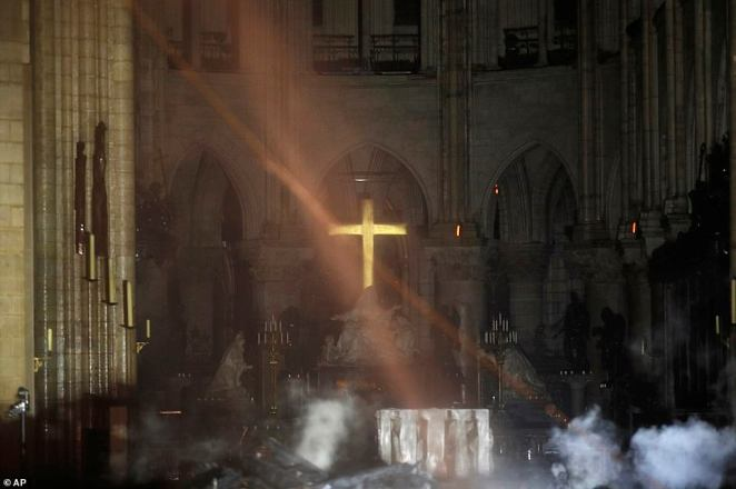 Smoke is seen around the alter inside Notre Dame cathedral on Monday evening. Miracolously the cross and altar have managed to survive the inferno