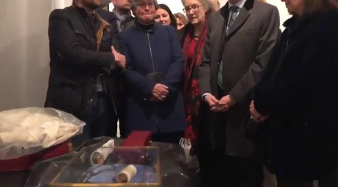 Worries onlookers were filmed looking at the salvaged antiquities on the night the cathedral's ancient roof burned to cinders