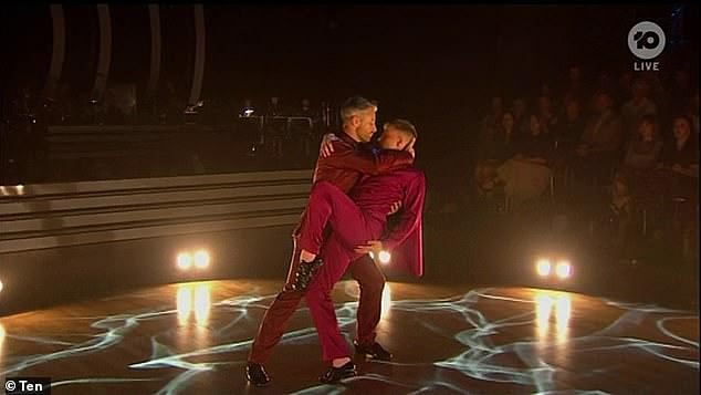 Hmm!Dancing with the Stars judge Sharna Burgess described Shane Jenek and Joshua Keefe's foxtrot performance on Monday night as a 'first for television'