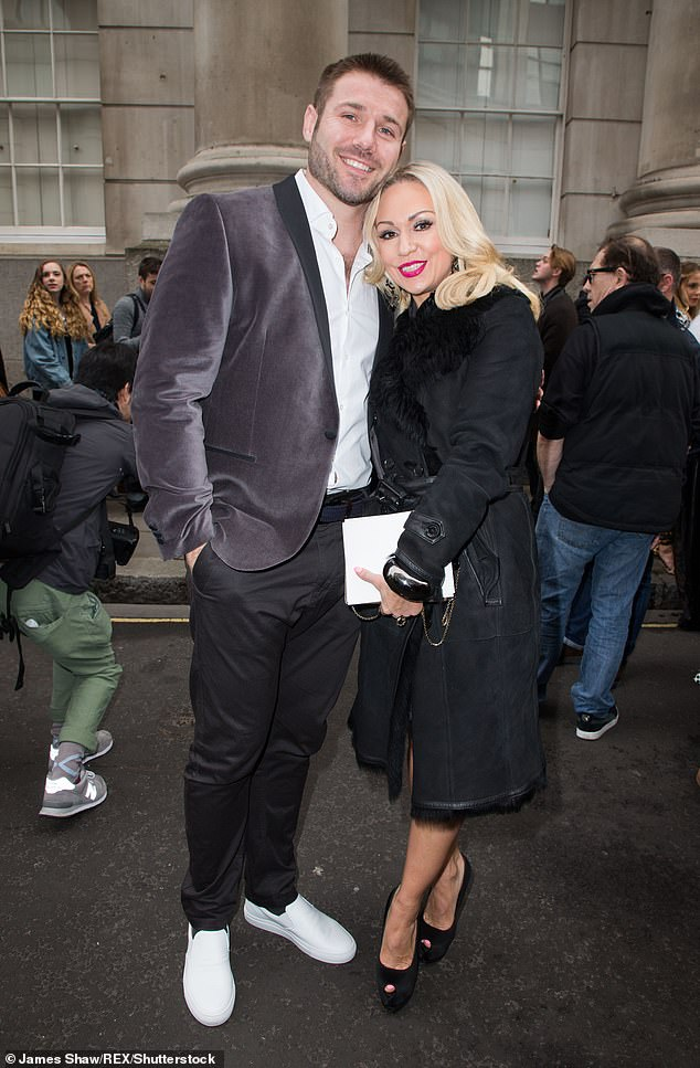 Cradled in: The professional dancer, 41, twice fell victim to the curse during her eight-year stint in the BBC Ballroom. Shown with Partner Ben 2017