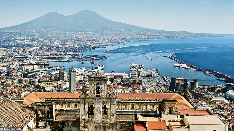 The MSC Splendida can be seen in between a mix of historic buildings as it docks in the Italian city of Naples. Passengers disembarking here have the opportunity to venture off and explore a number of picturesque sights includingthe Amalfi Coast and the ancient ruins of Pompeii and Herculaneum. Above, Mount Vesuvius dominates the skyline. More than two million people live in the vicinity of the cone and it is the only active volcano on mainland Europe
