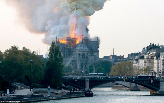 Teams of firefighters from across Paris were called in to try and put out the fire after it spread quickly through the cathedral on Monday evening