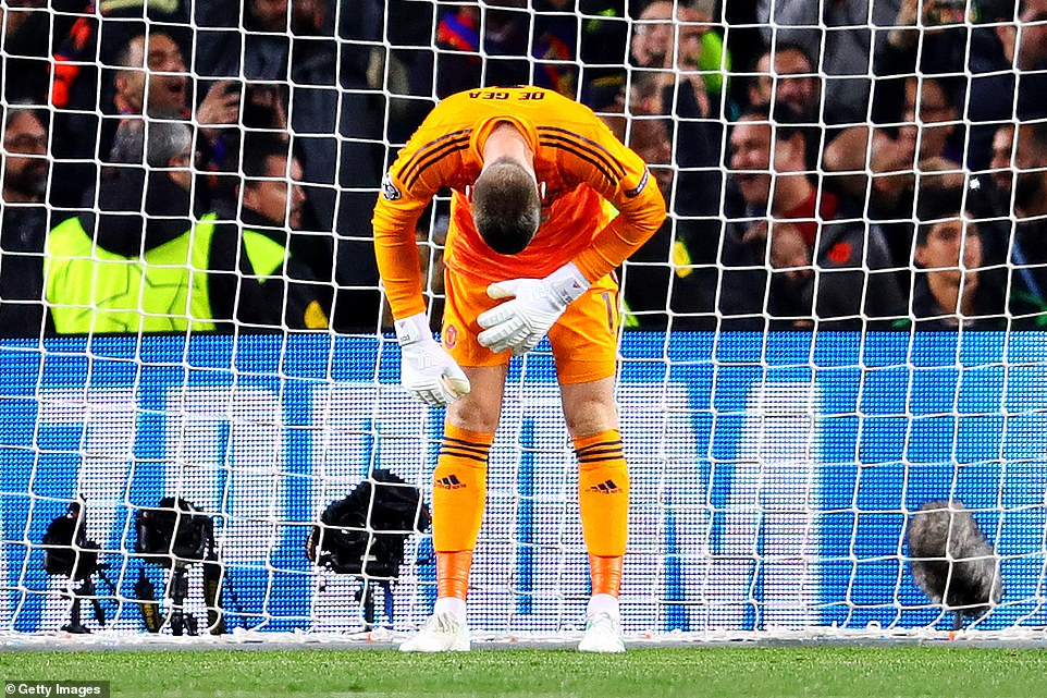 United's Spanish goalkeeper hunches over after making a rare mistake to give Barcelona their second goal at the Nou Camp