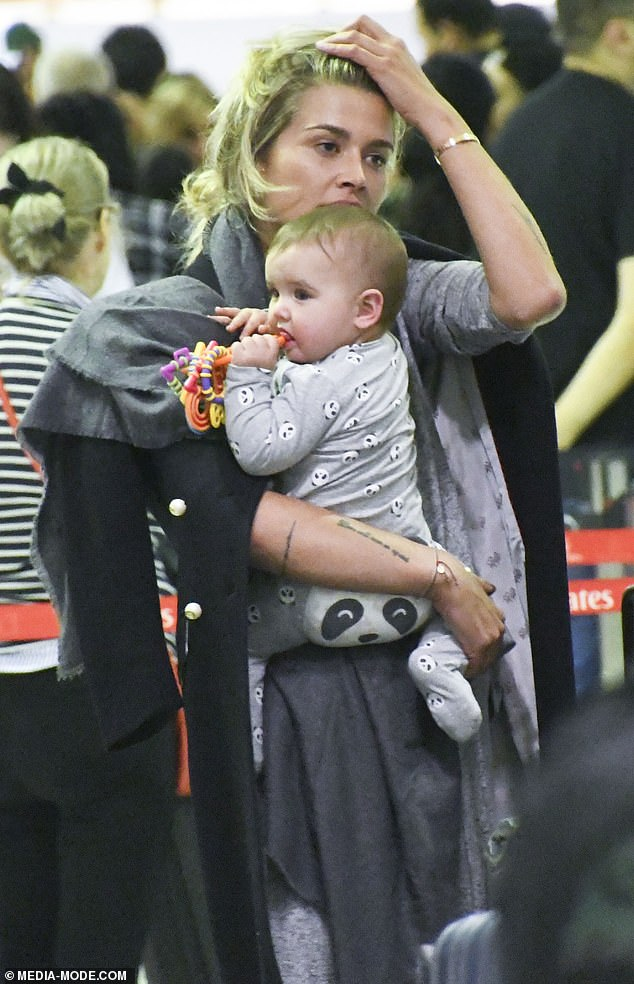 Work trip: Cheyenne, 30, was seen carrying her baby daughter Dahlia De La Lune while checking into a flight bound for Amsterdam, Netherlands