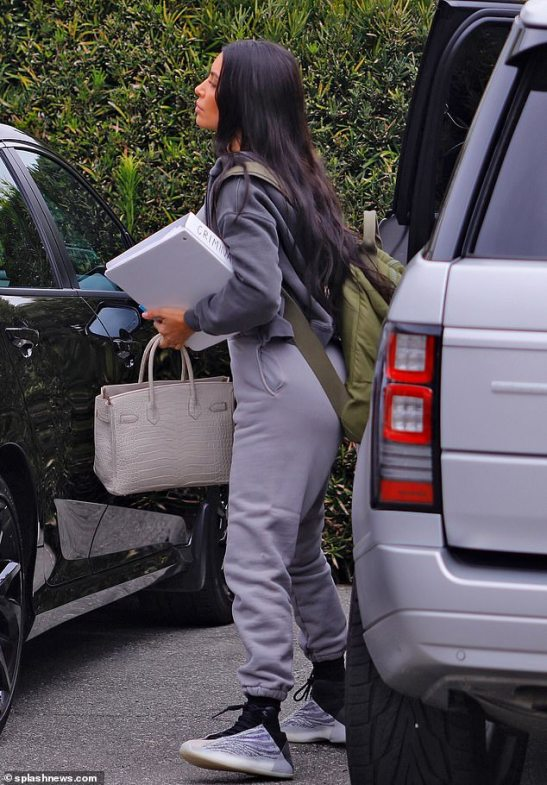 Dedicated: Kim Kardashian carried a binder into her torts exam in Los Angeles on Wednesday as she embarks on her law studies