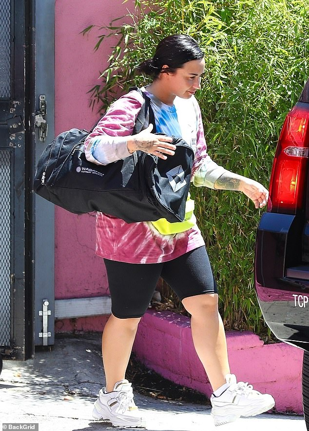 Sporty chic: Demi Lovato is pictured leaving her gym in West Hollywood on Wednesday