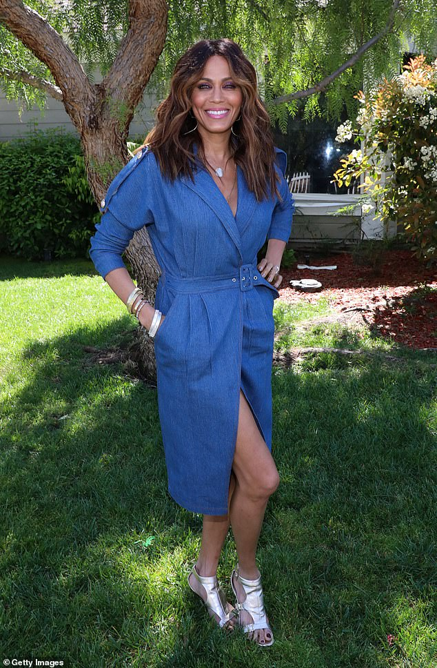 On trend: Also visiting Home & Family on Wednesday was actress Nicole Ari Parker, 48, who opted for a blue coat dress paired with shiny silver shoes