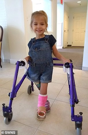 With the aid of a prosthetic and frame, Victoria slowly learned to walk