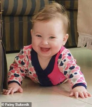 Shira Goldschmidt, eight months (pictured), from Israel, came down with a runny nose and a fever of 104F in December 2018