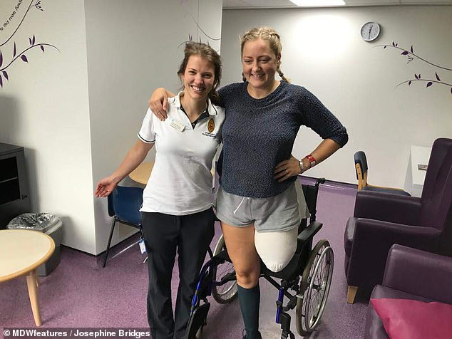 Mrs Bridges, pictured with a physiotherapist after her op in November last year, decided to have the amputation after her metal implants kept getting infected and slipping out of place