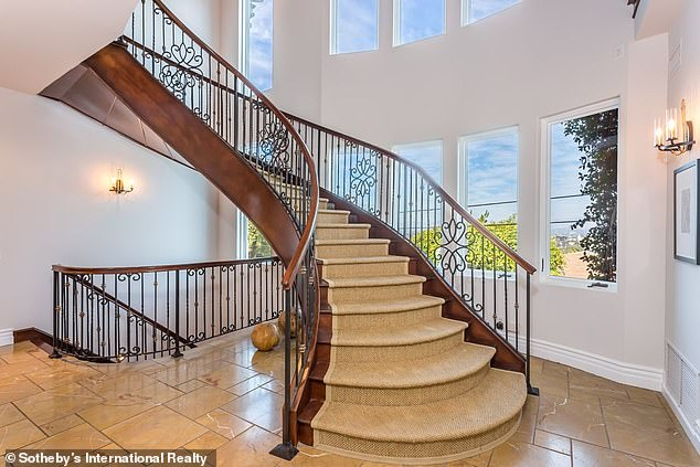 Staircase:The staircase leading to the second level is a mixture of wrought iron and wood, with the second level featuring an 'office/den convertible to a bedroom