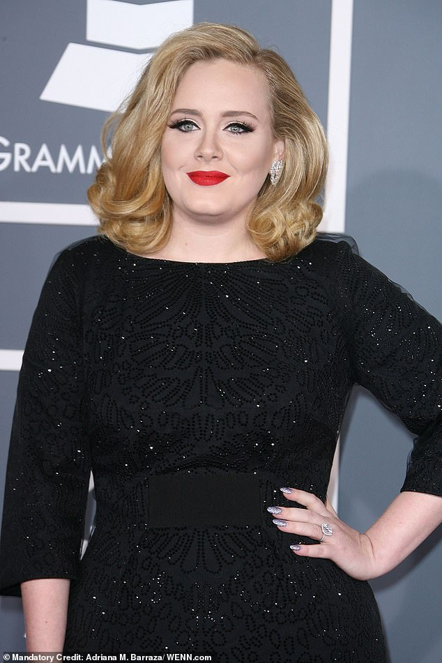 Split:Adele is reportedly planning to visit body piercer to the stars Brian Thompson after being introduced by best pal Jennifer Lawrence after her split (pictured2012)