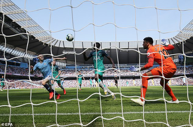 Phil Foden (left) heads in the winner against Spurs as City's title destiny in their own hands