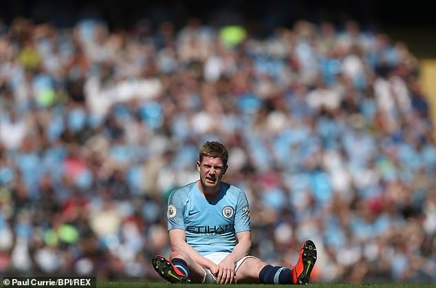 City ace Kevin De Bruyne looks dejected as he sits on the turf after suffering an injury setback