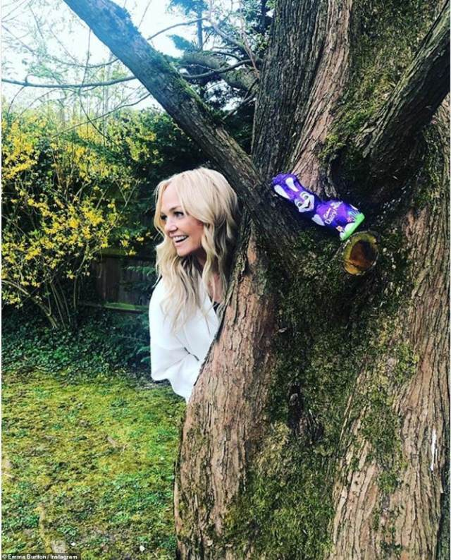 Treats: Spice Girl Emma Bunton ensured her children Beau, 11 and Tate, seven, were kept entertained by hiding chocolate treats around her sprawling country garden
