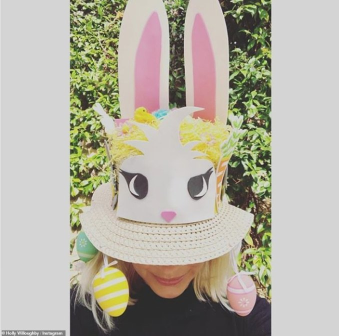 Celebrations: Holly Willoughby ensured she celebrated Easter in style on Sunday, donning an eccentric straw hat in a fun Instagram snap