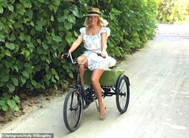Love life: Holly Willoughby spent her holidays in the luxury of the five-star Six Senses Laamu resort with her husband Dan Baldwin and their children Harry, nine, Belle, eight and Chester, four