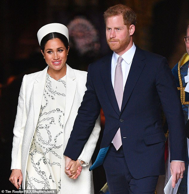 """'Both in the UK and abroad, there is a keen desire to connect with the royal family and these images act as the first opportunity for the public to """"meet"""" the new little one,' Tim said (pictured: Meghan Markle and Prince Harry)"""