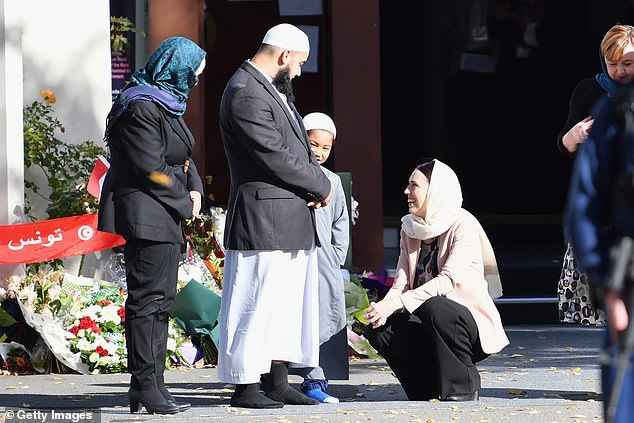 William was greeted by New Zealand Prime Minister Jacinda Ardern (right), wearing a cream-colored bandana, in front of the Al Noor Mosque
