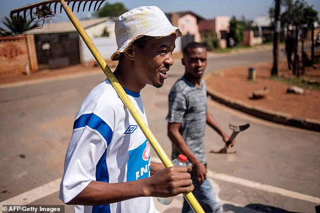 Chesney Van Wyk (left) and Lorenco Jacob (right walk through Eldorado Park after a land grabbing action earlier this month