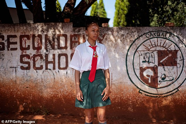 Student at Oakdale Secondary school Shanice Petersen, 18, stands outside the school's wall on April 18