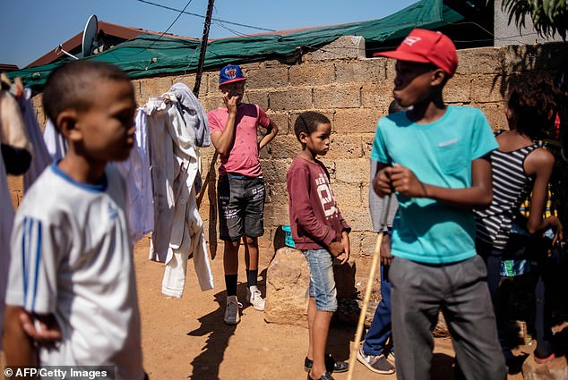Children belonging to the 'colored' community of Eldorado Park, South Africa, play in an outside yard. Twenty-five years after the fall of apartheid, members of the community continue to feel marginalized in their own country