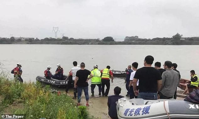 They first discovered the body of the six-year-old in the river at 8:35am on Wednesday, then the woman's body three hours later. The team finally found the youngest child at 12:05pm