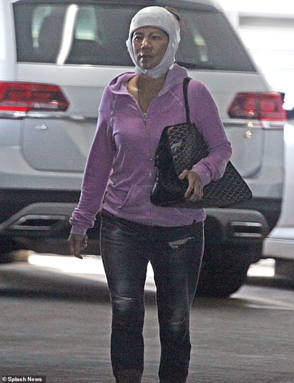On the go: Julie Chen, 49,was seen with white bandages wrapped around her face while out in Los Angeles on Wednesday afternoon