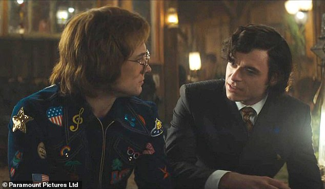 In love:The Merseyside native also shared his stance on kissing The Bodyguard's Richard, 32, who plays music manager and Elton's lover John Reid in the film (pictured together in the film)