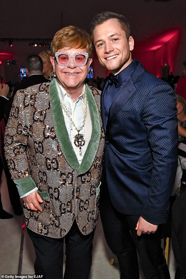 'I thought it was me':Taron, who recently branded his friendship with Sir Elton 'f**king surreal', was met with praise from the legendary artist as he enthused about the actor's portrayal (pictured together in February)
