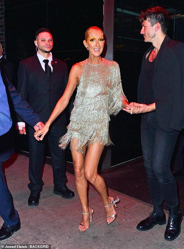 Celine Dion admires Katy Perrys burger costume at Met