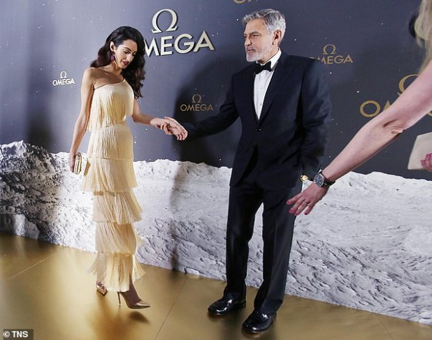 After you: Ever the caballleman, the Ocean's Eleven actor led his glamorous wife to her photo.