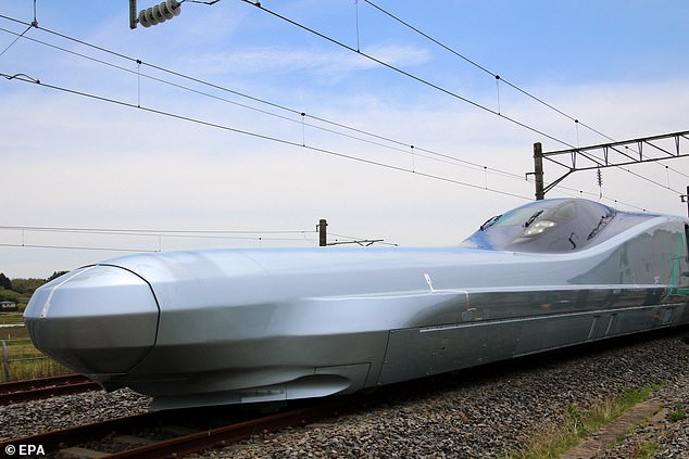 Dubbed the Alfa-X, it is capable of reaching speeds of up to 224 mph and consists of ten carriages. Its sleek silver design is matched by its incredible long and pointed nose which stretches for 72 feet n front of it (pictured)