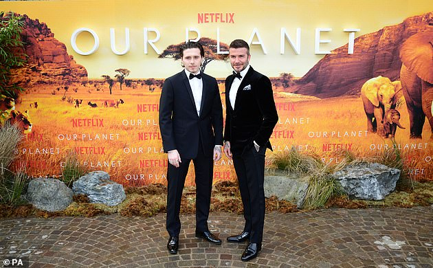 The 43-year-old former football star and his eldest son Brooklyn, 20, wore matching tuxedos at Netflix's premiere of David Attenborough's latest project, Our Planet.