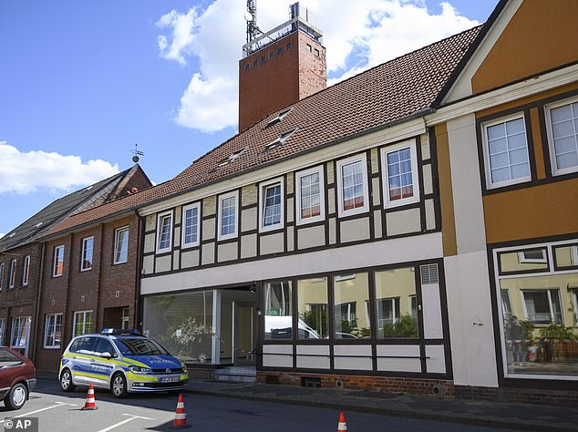 A police car stands in front of a building where the bodies of two women have been found at an apartment, in Wittlingen on Monday