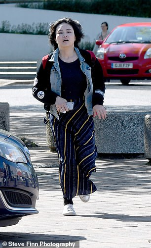 Yali Geng, 20, pictured arriving today at Maidstone Crown Court had a bank account in her name which had £150,000 paid into et between May 2015 and July 2018