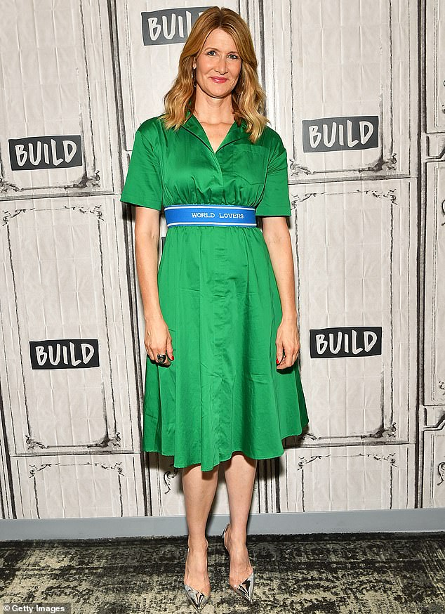 Green touch:Laura Dern wore a fun green dress with a belt that read World Lovers as she hit the BUILD series in New York City on Wednesday