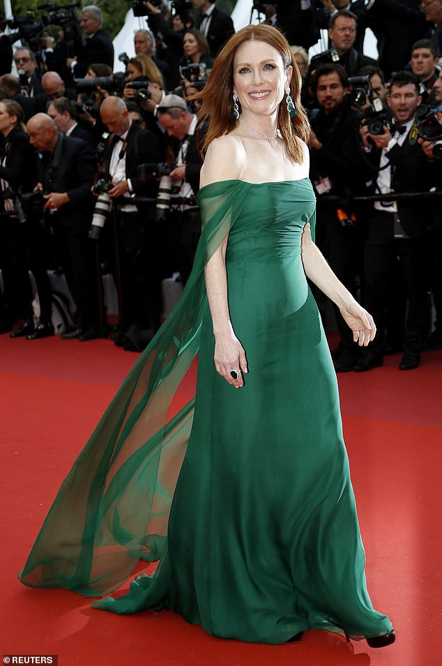 Radiant: On Tuesday, Julianne walked the red carpet on the opening night of the film festival in a stunning verdant gown, custom made by Dior that showcased her décolletage