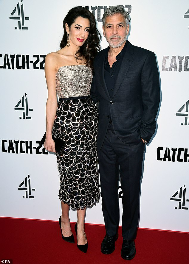 Power couple:George and Amal Clooney cut a stylish figure as they attended the premiere of his new mini-series Catch-22 at The Vue cinema in Westfield, London, on Wednesday