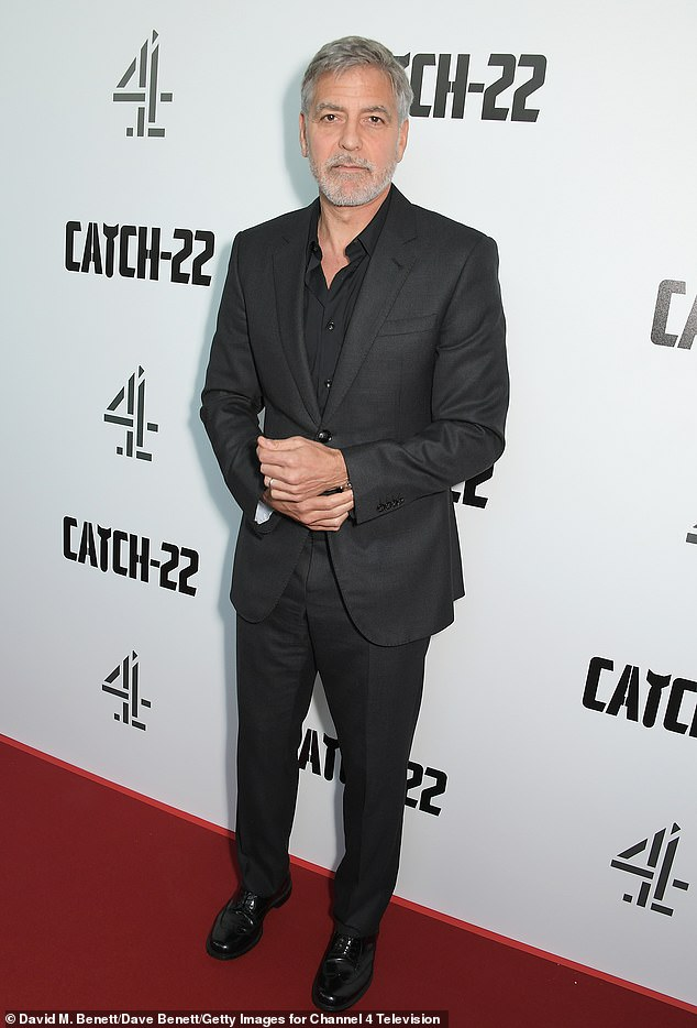 Dapper:George, 58, looked as dapper as ever in a monochrome outfit, wearing a dark grey suit and shirt which he wore slightly open