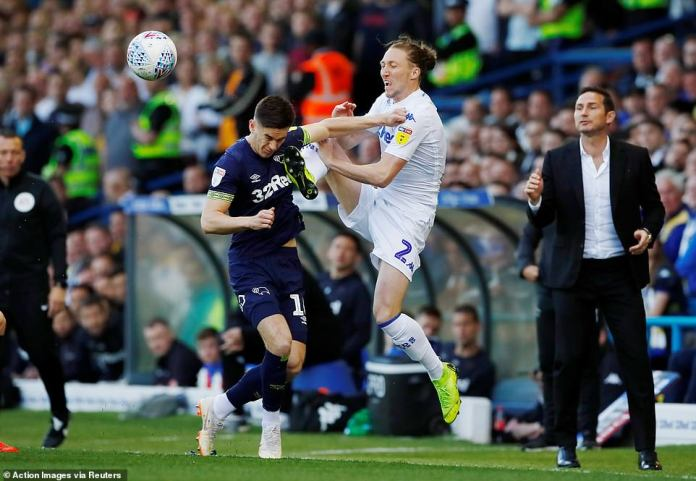 Leeds defender Ayling catches Tom Lawrence high with his boot as the pair compete for possession of the ball