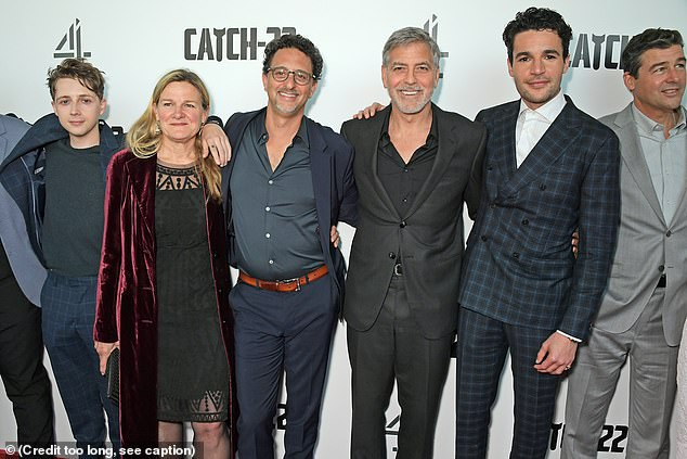 Teamwork: George flashed a wide smile as he posed with his colleagues (Pictured L-RGerran Howell, Ellen Kuras, Grant Heslov, George Clooney, Christopher Abbott and Kyle Chandler)