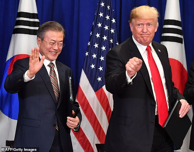 In this file photo taken on September 24, 2018 US President Donald Trump (R) and South Korean President Moon Jae-in gesture after signing a trade agreement at a bilateral meeting in New York, a day before the start of the General Debate of the 73rd session of the General Assembly. The White House announced Trump would visit South Korea around his June trip to Japan