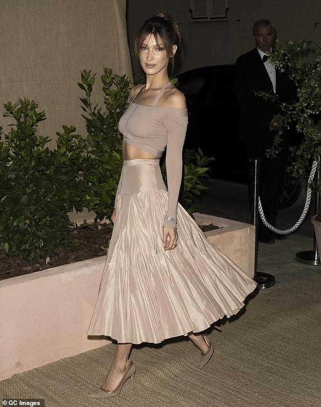 Elegant:Bella showcased her toned torso in an elegant sheer nude crop top with a matching bra underneath