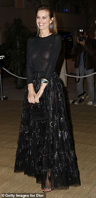 Daring: While modelEva Herzigová, 46, left nothing to the imagination as she went braless in a black sparkly sheer top with a sequinned encrusted skirt